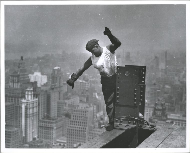 worker atop the Empire...